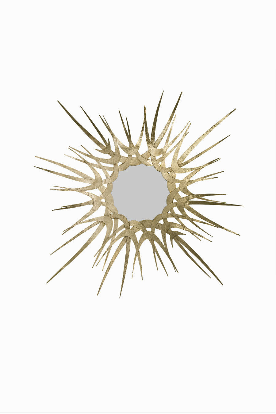 Sculptured gold tones of hammered and textured metal with a hint of hard edge surround a perfectly cut convex mirror.