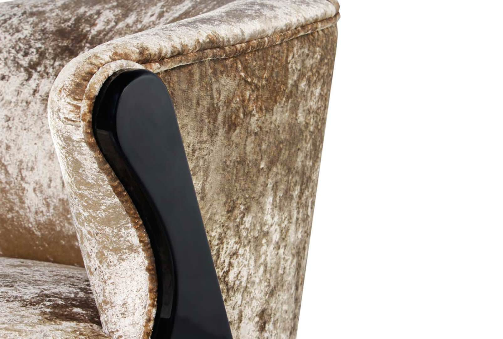 A plush upholstered seat is delicately framed by chicly lacquered mid-century modern legs stylishly capped in metal.
