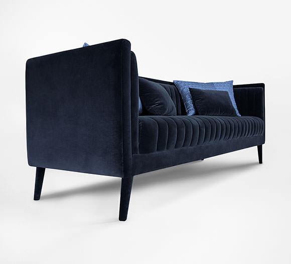 Fully upholstered in deep blue cotton velvet with an elegant seat and back geometric pattern, Azurite enhance any living room decor.