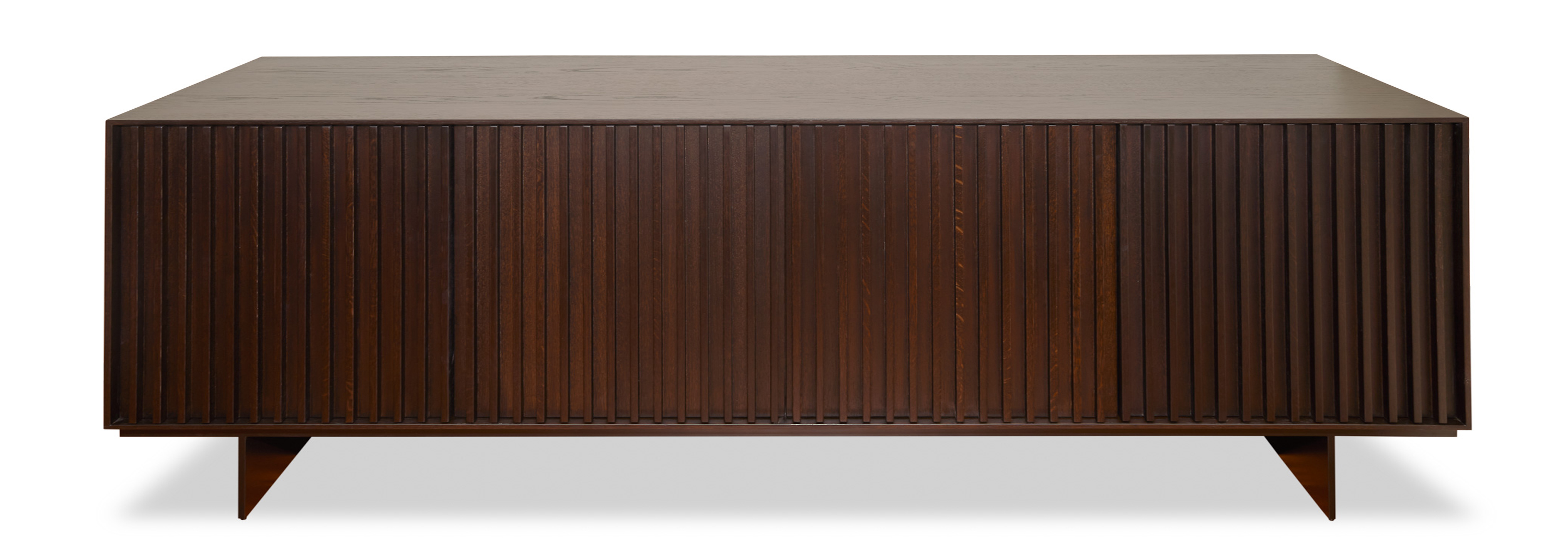 Our artisan team thrives on creating beautiful finishes and well-constructed pieces that defy their elegant appearance. This sleek sideboard features linear ashwood detailing on the doors complimented by sturdy slim metal legs.